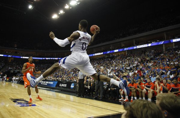 Kansas forward Thomas Robinson turns to fire a pass as he soars out of bounds against Illinois during the first half on Sunday, March 20, 2011 at the BOK Center in Tulsa.