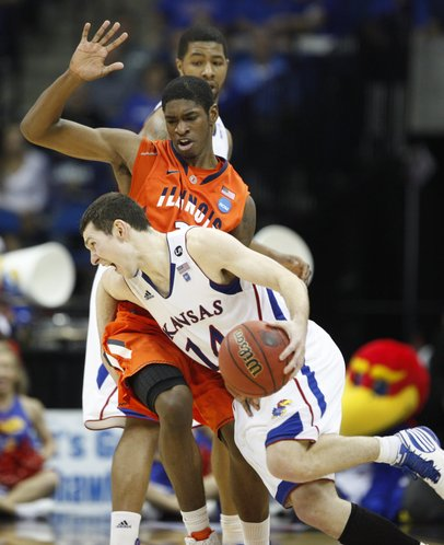 Kansas guard Tyrel Reed works his way around Illinois defender Brandon Paul during the second half on Sunday, March 20, 2011 at the BOK Center in Tulsa.