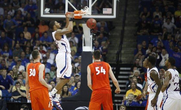 Kansas forward Markieff Morris delivers on an alley-oop dunk from teammate Tyshawn Taylor during the second half against Illinois on Sunday, March 20, 2011 at the BOK Center in Tulsa.