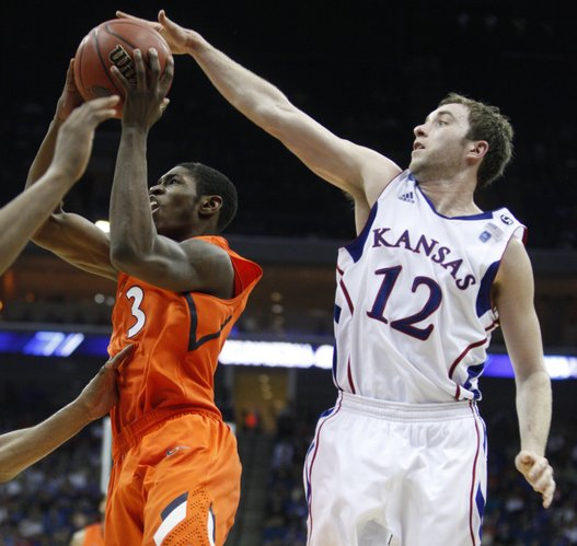 Kansas guard Brady Morningstar blocks a shot by Illinois guard Brandon Paul during the second half Sunday, March 20, 2011 at the BOK Center in Tulsa.