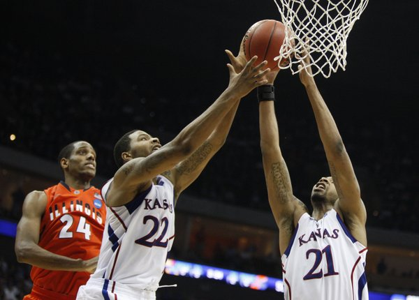 Kansas forwards Marcus (22) and Markieff Morris pull a rebound from Illinois forward Mike Davis during the second half Sunday, March 20, 2011 at the BOK Center in Tulsa.