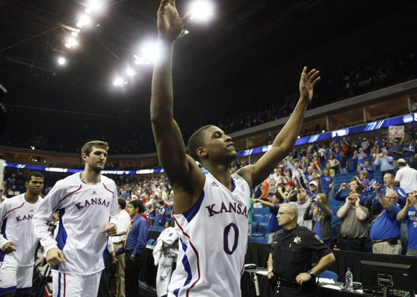 Kansas forward Thomas Robinson acknowledges the crowd as the Jayhawks leave the court following their 73-59 win over Illinois on Sunday, March 20, 2011 at the BOK Center in Tulsa.