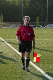 Referee Jim LaPoint works the sideline in this 2010 file photo. LaPoint, also a KU professor, has officiated more than 2,000 soccer games at the college and high school level.