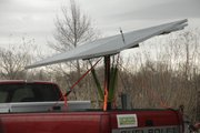 Mark Moser, creator of Konza Portable Solar Trackers was in Lawrence Tuesday, March 22, 2011, to show his creation while it was used to produce power for sheep shears.