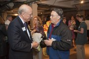 Sen. Pat Roberts, left, talks with Lawrence Mayor Mike Amyx Wednesday, March 23, 2011, at the Lawrence Chamber of Commerce After Hours meeting. Sen. Roberts was the guest speaker for the evening.