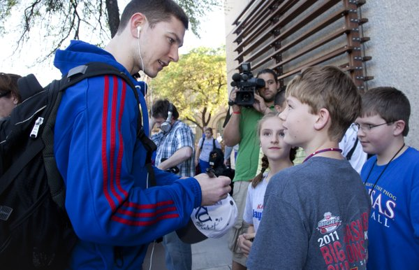 Kansas guard Tyrel Reed talks with Chonner Ludolf, 11, front, Braelyn Falls, 13, and Brogan Falls, 12, right, upon the team's arrival at the Hyatt Regency San Antonio on Wednesday, March 23, 2011. The three kids are from Leroy, Kan., which is near Reed's hometown of Burlington.