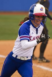 Kansas' Maggie Hull races to home plate for a run during the opening game in a doubleheader against Missouri on Wednesday, March 23, 2011 at Arrocha Ballpark.