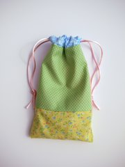 Put some fabric squares to use and you have a bag ready for gift-giving, wrangling small items in your purse or a myriad of other uses.