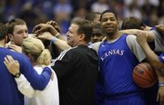 Kansas head coach Bill Self, Marcus Morris and the rest of the Jayhawks come together in a huddle during a day of practices and press conferences at the Alamodome in San Antonio on Thursday, March 24, 2011.