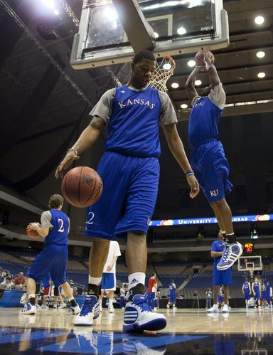 Kansas forward Marcus Morris works through a drill with his teammates during a day of practices and press conferences at the Alamodome in San Antonio on Thursday, March 24, 2011.