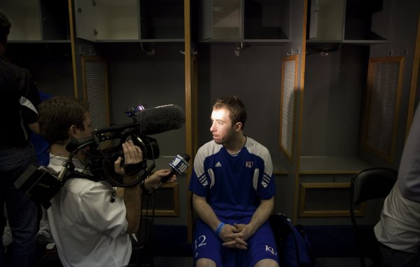 Kansas guard Brady Morningstar sits for an TV interview during a day of practices and press conferences at the Alamodome in San Antonio on Thursday, March 24, 2011.