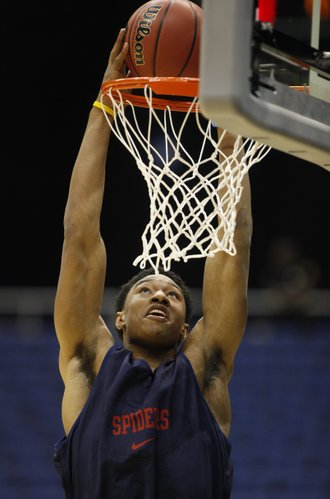 Richmond forward Justin Harper elevates for a dunk during a day of practices and press conferences at the Alamodome in San Antonio on Thursday, March 24, 2011.