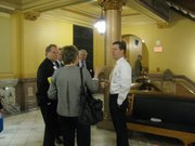 Gov. Sam Brownback can be seen every now and then walking around the Capitol and speaking with lobbyists, legislators and others while he drinks a cup of coffee.