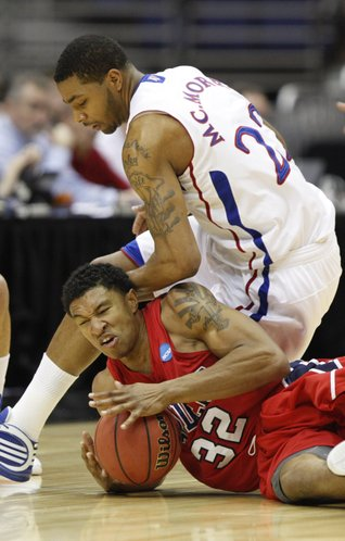 Kansas forward Marcus Morris and Richmond forward Justin Harper battle for a loose ball during the first half on Friday, March 25, 2011 at the Alamodome in San Antonio.