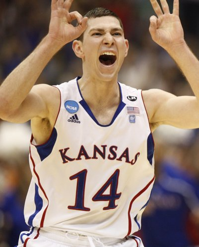 Kansas guard Tyrel Reed celebrates a three by teammate Josh Selby against Richmond during the first half on Friday, March 25, 2011 at the Alamodome in San Antonio.