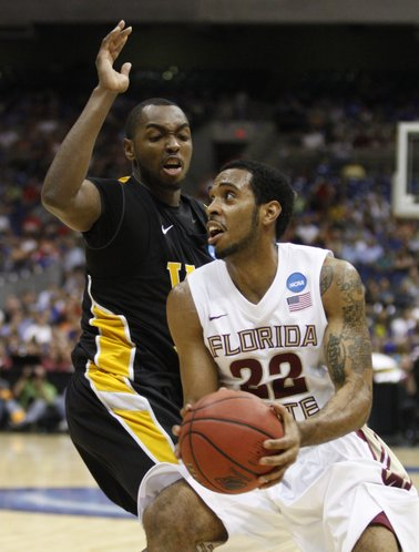 Virginia Commonwealth guard Ed Nixon defends a drive by Florida State guard Derwin Kitchen during the first half on Friday, March 25, 2011 at the Alamodome in San Antonio.