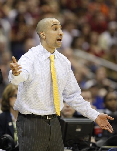 Virginia Commonwealth head coach Shaka Smart gets the attention of his defense during the first half on Friday, March 25, 2011 at the Alamodome in San Antonio.