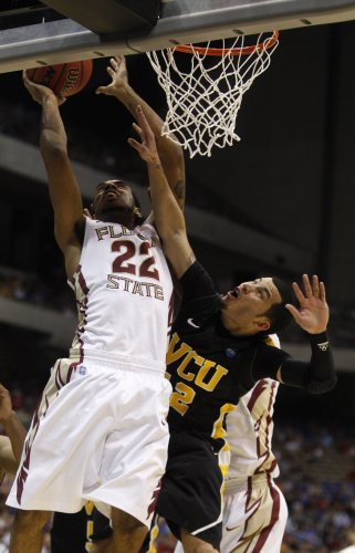 Virginia Commonwealth guard Joey Rodriguez defends Florida State guard Derwin Kitchen's shot during the first half on Friday, March 25, 2011 at the Alamodome in San Antonio.