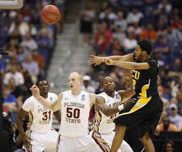 Virginia Commonwealth guard Brandon Rozzell fires a pass over Florida State defenders Chris Singleton (21) Jon Kreft (50) and Michael Snaer (21) during the first half on Friday, March 25, 2011 at the Alamodome in San Antonio.