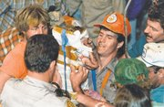 In this October 1987 file photo, rescue workers carry 18-month-old Jessica McClure to safety in Midland, Texas, after she was trapped for 58 hours when she plunged 22 feet into an abandoned water well. Now married with two children, Jessica McClure Morales turns 25 today and gains access to a trust fund of up to $800,000, the result of donations from thousands of sympathetic strangers across the globe glued to the television until she was freed.