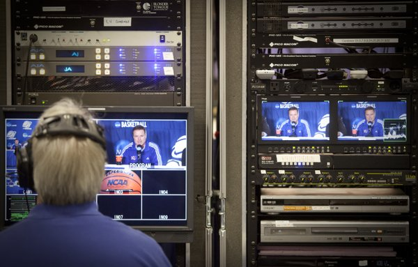 Kansas head coach Bill Self is seen on the video monitors of production equipment during a press conference on Saturday, March 26, 2011 at the Alamodome in San Antonio.