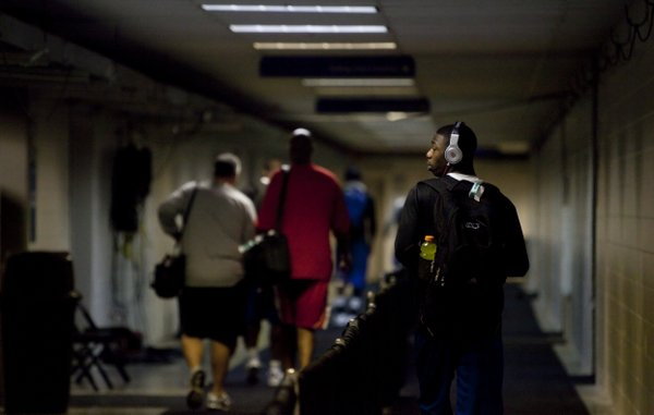 Kansas guard Elijah Johnson listens to his headphones as he and the team leave the Alamodome following a round of interviews and press conferences on Saturday, March 26, 2011 at the Alamodome in San Antonio.