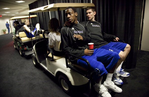 Kansas guards Tyshawn Taylor and Tyrel Reed wait to be escorted to press conferences on Saturday, March 26, 2011 at the Alamodome in San Antonio.