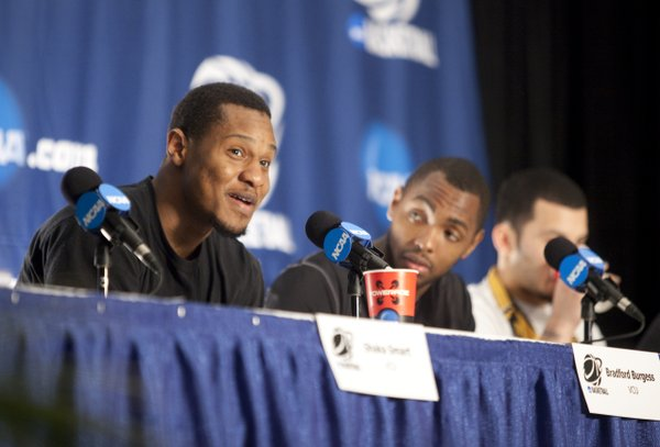 Virginia Commonwealth forward Bradford Burgess answers a question during a press conference on Saturday, March 26, 2011 at the Alamodome in San Antonio.