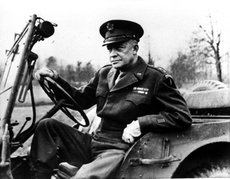 General Dwight Eisenhower, Supreme Allied Commander, sits at the wheel of his jeep somewhere in France as he prepares to drive to meet representatives of each Allied country to deliver his Christmas message to all Allied forces December 1944.  (AP Photo)