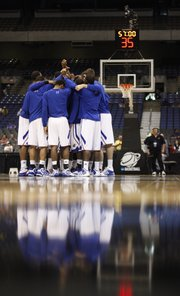 The Kansas Jayhawks come together in a huddle prior to tipoff against Virginia Commonwealth on Sunday, March 27, 2011 at the Alamodome in San Antonio.