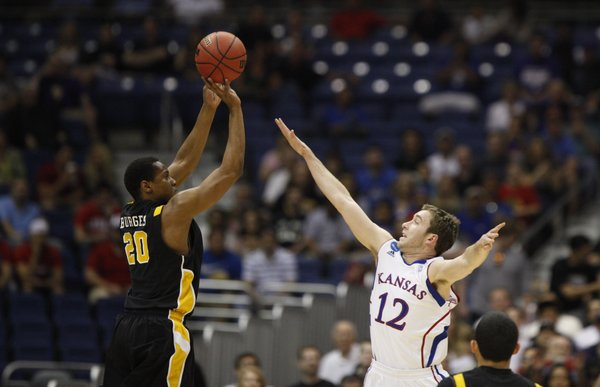 Kansas guard Brady Morningstar defends a three-pointer from Virginia Commonwealth forward Bradford Burgess during the first half on Sunday, March 27, 2011 at the Alamodome in San Antonio.