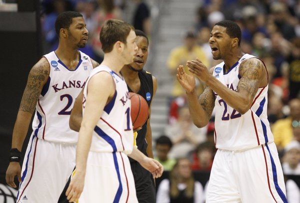 Kansas forward Marcus Morris pleads to Markieff Morris and Brady Morningstar to get it together against Virginia Commonwealth during the first half on Sunday, March 27, 2011 at the Alamodome in San Antonio.