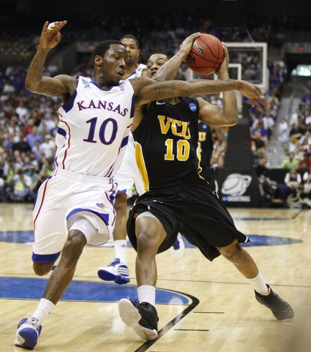 Kansas guard Tyshawn Taylor defends a drive by Virginia Commonwealth guard Darius Theus during the second half on Sunday, March 27, 2011 at the Alamodome in San Antonio.