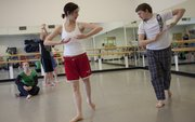 Justin Hundley, right, choreographs some steps for Jennifer Flynn, left, during rehearsals for the 940 Dance Company at the Lawrence Arts Center, 940 N.H.