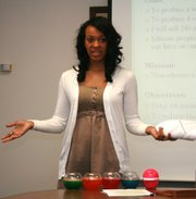 Taylor Eubanks, a student at Lawrence High School, presents her plans for Fresh Globe Air Fresheners, which would be an organic operation. Eubanks was among 21 LHS students to make a presentation Wednesday, March 30, 2011, at Kansas University's School of Business, as part of a collaborative program.