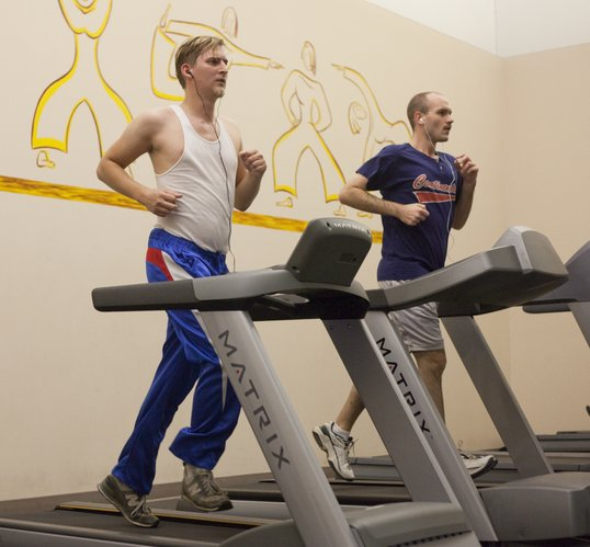 Adam Braun, left, and Kelly John Clark, both of Lawrence, exercise on treadmills Wednesday at the Community Building, 115 W. 11th St. Douglas County is the eighth healthiest county in Kansas, according to a report released late Tuesday. But that's a four-spot drop from last year.