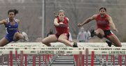 Lawrence High's Krista Costa, center, tries to keep up with teammate Tamiya Green, right, in the 100 hurdles Wednesday, Mar. 30, 2011 at LHS.