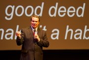"Greg Mortenson, author of ""Three Cups of Tea,"" speaks at the Lied Center on Wednesday. Mortenson said his grandmother gave him the advice to ""do a good deed every day and make it a habit."""