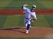 Kansas pitcher T.J. Walz delivers a pitch during the first inning of Kansas' game against Baylor Friday, April 1, 2011 at Hoglund Ballpark. Kansas won, 6-2.