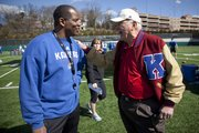 Kansas head football coach Turner Gill has a laugh with former coach and longtime KU football supporter Don Fambrough as the two talk football during spring workouts at the practice facility on Friday, April 1, 2011.