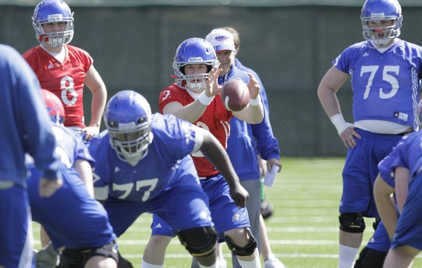 Quarterback Jordan Webb takes a snap as the offense runs through plays during spring workouts at the practice facility on Friday, April 1, 2011.