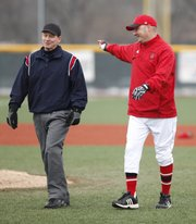 Lawrence High head baseball coach Brad Stoll talks with an umpire during the fourth inning against Shawnee Mission Northwest on Thursday, March 31, 2011 at LHS.