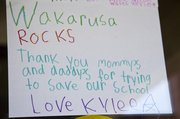 A Wakarusa Valley student's poster shows appreciation for efforts to save the school. The Lawrence school board voted to close the school southeast of Clinton Lake at the end of the school year. Leaders have yet to determine what to do with the school building, which was soon to celebrate its 50th birthday.