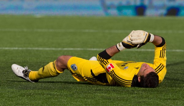 Vancouver Whitecaps' Jay Nolly lies on the field after allowing a goal by Sporting Kansas City's Teal Bunbury during the first half of an MLS soccer game in Vancouver, British Columbia, on Saturday, April 2, 2011.