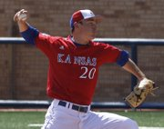Kansas' Nolan Mansfield delivers a pitch during Kansas' baseball game against Baylor Sunday, April 3, 2011 at Hoglund Ballpark. KU lost, 12-4.