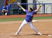 Kansas' Kristin Martinez winds up for a pitch during Kansas' softball game against Nebraska Sunday, April 3, 2011 at Arrocha Ballpark. KU fell, 7-1.