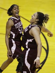 Texas A&M players Sydney Colson, left, and Danielle Adams celebrate their 63-62 win over Stanford. A&M won Sunday in Indianapolis to advance to Tuesday's national championship.