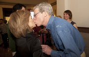 City Commission candidate Bob Schumm leans over to kiss his wife, Sandra, upon her arrival at the Douglas County Courthouse on election night, Tuesday, April 5, 2011. Schumm was the top vote-getter in the City Commission race.