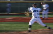 Free State pitcher Cody Kukuk delivers a pitch against Olathe East on Tuesday, April 5, 2011 at FSHS.