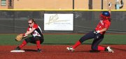 Lawrence High's Mallory Reynolds gets the force out on Olathe North's Megan McCracken in the sixth inning Tuesday, April 5, 2011 at LHS.